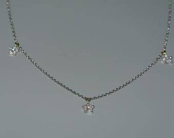 14k white gold diamond in a star pendant.