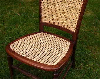 Antique Victorian nursing chair with new hand-wove cane seat and back