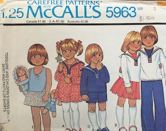 McCall's pattern 5963. Vintage 1978 girl boy child pullover dress with sailor collar, top, skirt, pants and shorts. Size 2