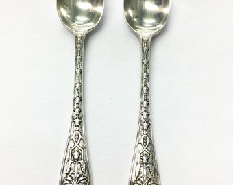 Solid Silver Spoons.