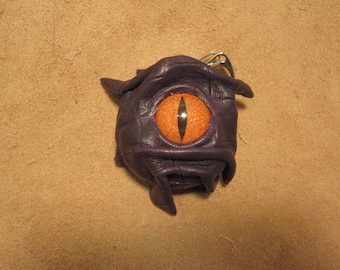 Grichels leather and stainless steel collapsible shot cup - scaly dark purple with poppy orange slit pupil reptile eye