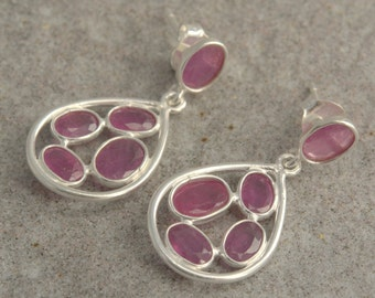 Sterling silver earrings with faceted ruby