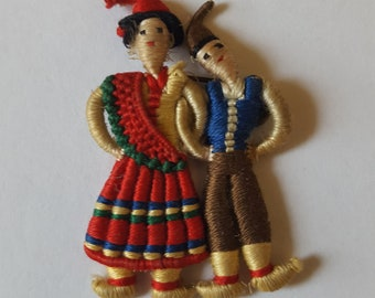A Madeira souvenir colourful handcrafted strin yarn doll brooch