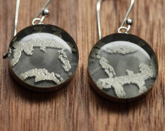 Silver abstract earrings made from recycled Starbucks gift cards. sterling silver and resin.