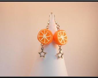Boucles demi orange en Fimo et breloque étoile.