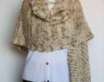 Hand woven beige wool stole at the frame