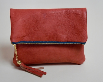 Peach Fold Over Clutch With Tassel