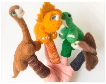 The world of dinosaurs - 4 puppets has fingers/The world of dinosaurs - 4 finger puppets wool