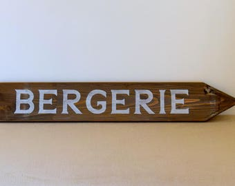 """Decorative Panel in weathered wood with the word """"Barn"""" painted in white on Brown background"""