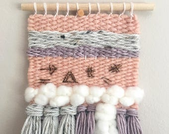 Woven Wall Hanging // pastel weaving with fringe and embroidery. Pink, copper, purple, and grey. Nursery decor, little girl's room