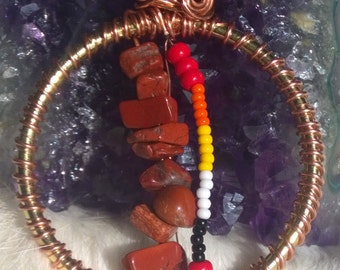 Red Jasper with white, black, orange, yellow and red beads