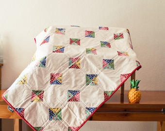 Handmade baby quilt with feedsack reproduction fabrics