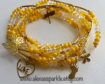 Yellow transcendent beaded bracelets with gold plated charms - Semanario amarillo transendente con dijes de chapa de oro