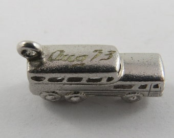Sterling Silver Charm of a Double decker Bus with the date Aug. 73 on the Roof.