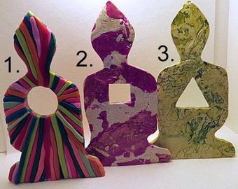 Ornaments. Three meditating figures in different design effects. Unique home or office decorations with a centre opening and colour effects.