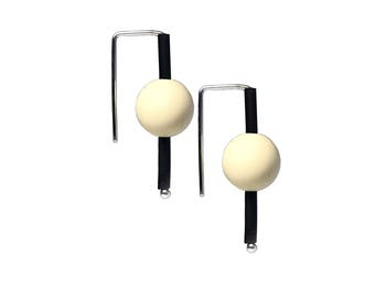 sculptural earrings in cream and black,  rubber and silver handmade by Frank Ideas