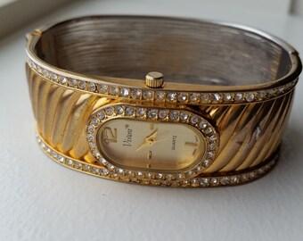 Gold Tone and Rhinestone Hinged Bangle Watch