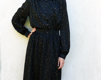 "Vintage long sleeved dress - black with gold paisley design . . . . . . . . . . . . . ""Like"" our fb page for 10% discount"