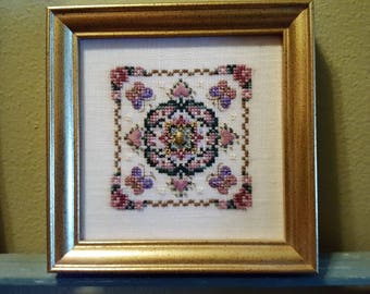 Among the Roses - finished cross-stitch, pattern by Just Nan
