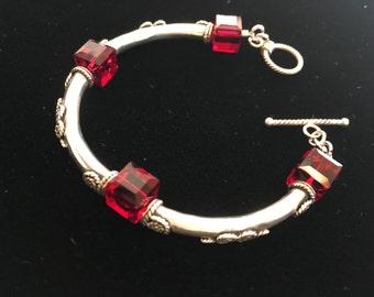 sterling silver tube bracelet with red 8mm Swarovski Crystal cubes