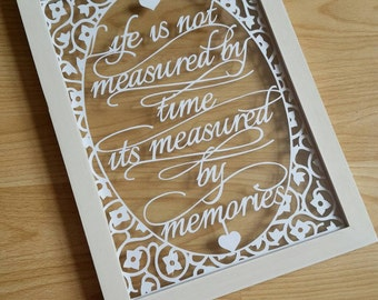Life is not measured by time, it's measured by memories floral papercut in an a4 floating frame