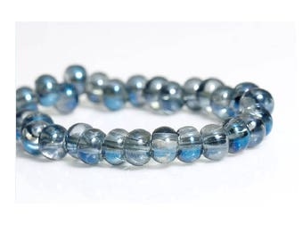 Set of 25 blue skewed transparent glass beads