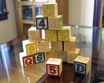 "17 Small Wooden Alphabet Blocks – 1"" square"