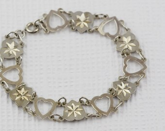Silver Cut out and Etched Heart Link Bracelet