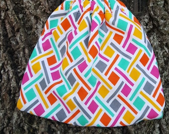 Fleece Lined Stirrup Covers: Multicolored Geometric Print Cotton Lined with White Fleece