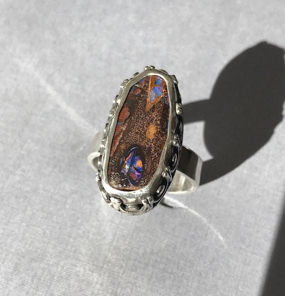 Boulder Opal ring with detailed bezel