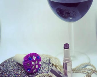 Purple beaded and jewled wine stop