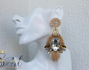 Handmade earrings in beige