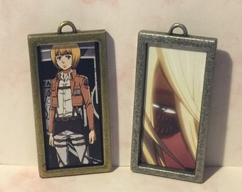 Set of two Attack on Titan pendants.
