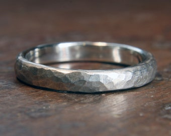 Recycled sterling silver or gold 3mm wide planished wedding ring. Hand made in the UK.