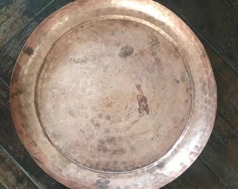 Large hand pounded copper plate from Nepal