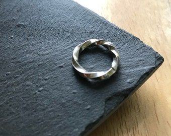 Small square twist ring.