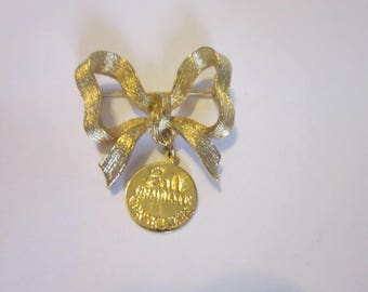 Vintage Gold Tone Bow Brooch Bali Graduate Corsetiere Badge Pinback