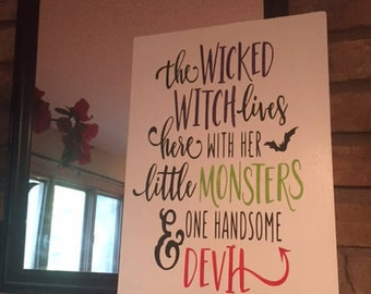 The wicked witch lives here with her little monsters and one handsome devil. Wood sign. Rustic decor. Handmade. Handpainted. Halloween. Fall