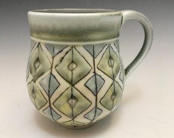 Soda fired large porcelain mug in celadon and diamonds