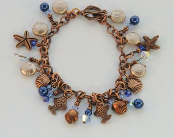 Antique copper sea charm bracelet, blue and gold pearl coin ocean bracelet, swarovski starfish, shells, fish charms, beach jewelry, gifts