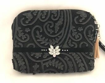 Faux leather lace clutch bag