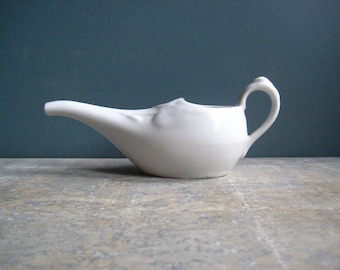 a vintage French feeding cup, long spouted jug, white porcelain, elegant