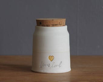 ready made urn. collared shape white porcelain clay pottery urn, pet urn with bone white glaze and gold heart