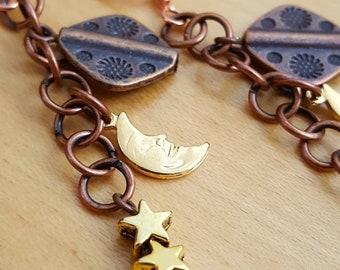 Sun Moon Stars copper and goldtone dangle earrings