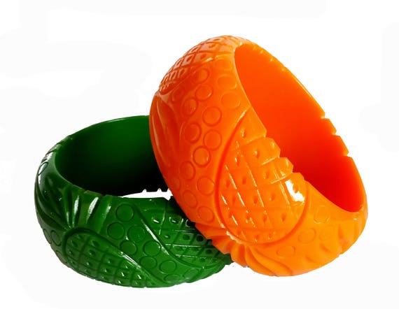 1950s Jewelry Styles and History Very nice carved fakelite bakelite pineapple bangle reproduction- 1940s look - awesome chunky quality!Very nice carved fakelite bakelite pineapple bangle reproduction- 1940s look - awesome chunky quality! $21.47 AT vintagedancer.com