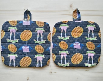 Set two pot holders at stranger things