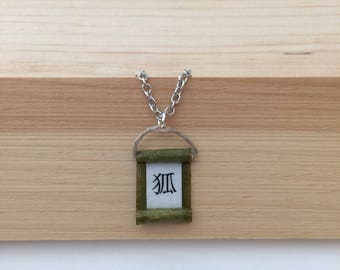 Fox in Japanese calligraphy on a green minimal necklace