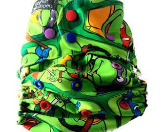 Teenage mutant Ninja turtles cloth diapers with multi-color snaps. (Available in pocket or AI2 with snap-in insert)