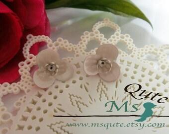 Orchid stud earrings -  creamy white