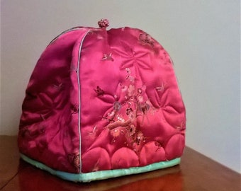 Large 1960s Chinoiserie toaster cozy. Pink chinese brocade with birds, cherry blossoms. Vintage large padded cosy/cozy.